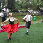 Bavarian Dance dancers showing people at a park their elegant moves.
