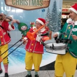 The grooves dressed in our custom made elf costumes playing at the Hong Kong International Airport .