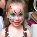 Lovely butterfly face painting.