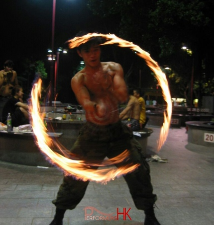 Hong Kong Juggler performing with fire poi at a corporate event