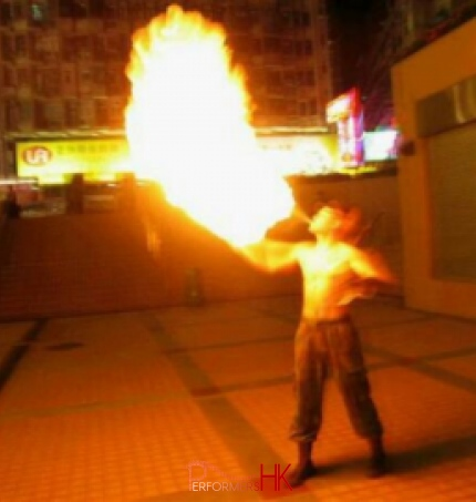 Juggler in HK performing breathing fire act a corporate function.