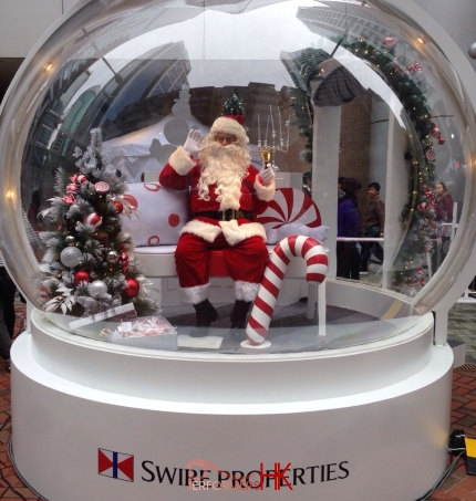 Santa clause inside a giant snow globe in Hong Kong