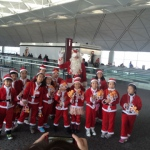 Santa Rowan at the Airport with littel santa helpers