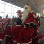 Santa Rowan getting attension from kids at the airport