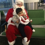 Santa Rowan with his little fan at the airport