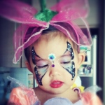 Her signature butterfly face paint.