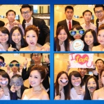 A group using props from photobooth team taking fun pictures at an event at a wedding event.