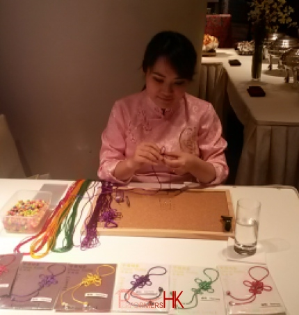 Hong Kong artist knitting Chinese knotting at a corporate event