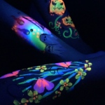 UV face painting,glowing under UV light.