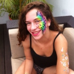 Rainbow color peafowl pattern face paint.