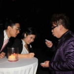 Magician in Hong Kong performing roving magic to two guests at a corporate cocktail event