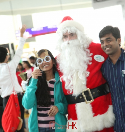 Santa posing with patrons at Hong Kong airport