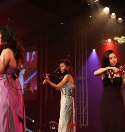 Three Hong Kong violinist performing electric trio at a watch company product launch event