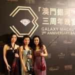 Violinists in Hong Kong taking photo in front of the backdrop before the Galaxy Macau 3RD Anniversary Ball start