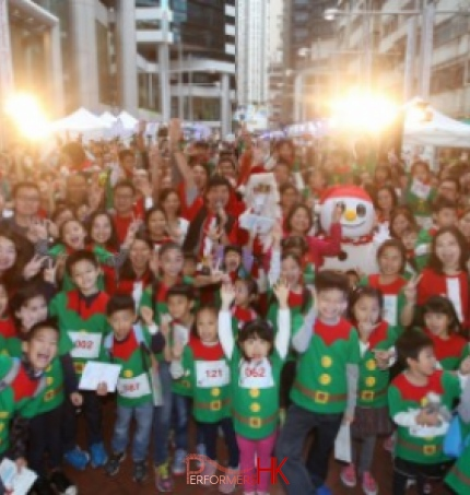 Hong Kong performer dress as Santa Claus and snow man with 400 participants who dress as Elf taking picture at Swire Properties three-day Christmas street fair in Tai Koo Place, Quarry Bay.