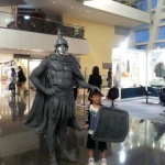 Silver man Centurion human statue wearing custom made costume at Festival walk for American Express.