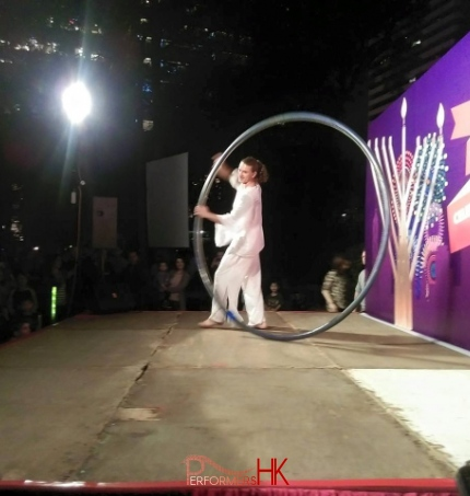 A Hong Kong acrobatics artist performing with wheel at a Hong Kong Xmas corporate event