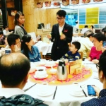 Walk around magician performing table magic for a family to promote the new menu at a Hong Kong restaurant