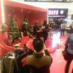 Our drummer tapping along to DJ at the Mira Mall Hong Kong.