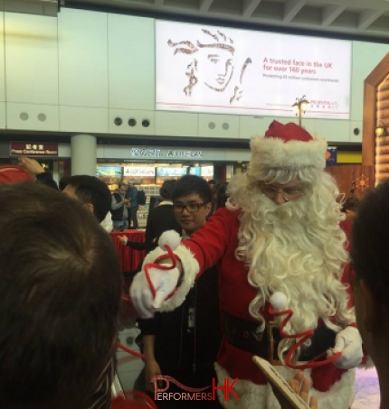 The Santa performer in HK giving out Christmas giveaway at the Hong Kong airport Xmas Event.