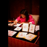 Professional Chinese calligrapher writing on Chinese style banners.