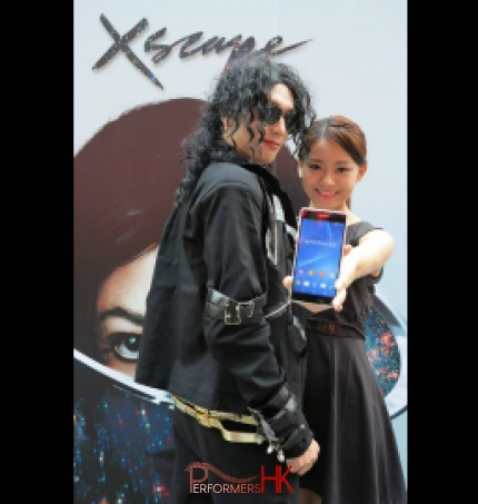 Woman taking selfie with Michael Jackson impersonator