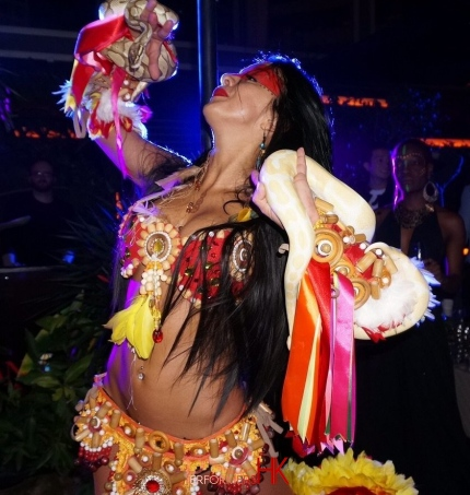 A Dancer in HK dancing with two snake at a cocktails event