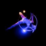 Elegant movements on a hoop in midair.