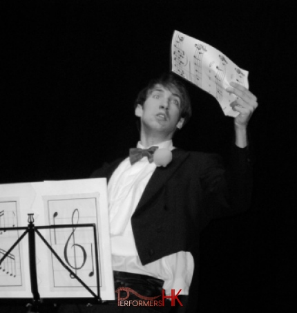 Magician performing a trick with sheet music