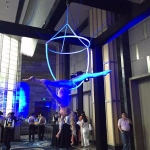 Performer also performs with elegant movement on the hoop besides serving champagne to guests.