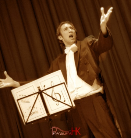 A Kong Kong stage magician performing his comedy musical magic show at a corporate annual dinner
