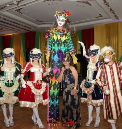 Hong Kong professional stiltwalker in Venetian LED costume posing with three Maries Marionette dancers and juggler at a corporate Masquerade theme annual dinner