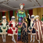 The Venetian LED Stiltwalker with Maries Marionette at a Masquerade ball.
