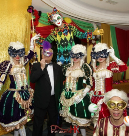 Stiltwalker in Venetian LED costume posing with three Maries Marionette dancers and juggler at a Hong Kong corporate Masquerade theme event