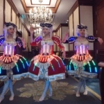 Our three dancers in the Grand hallway of the Island Shangri-la  Hong Kong rehearsing before corporate show.