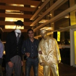 Headless man along with gold living statue performing for the Reliance Group in Macau.