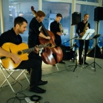 A 4-piece band featuring guitar, cello, trumpet and sax.