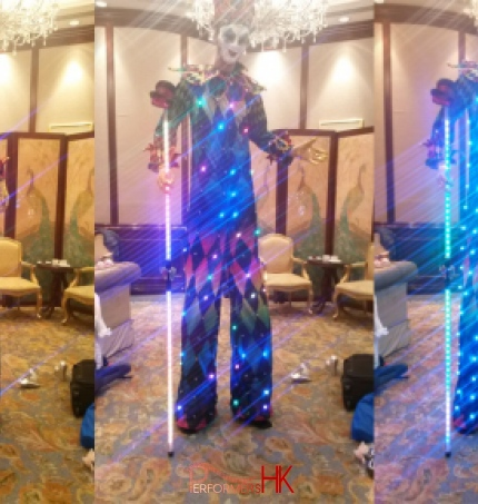 Three pictures of HK stiltwalker in a Venetian LED costume which have different  patterns