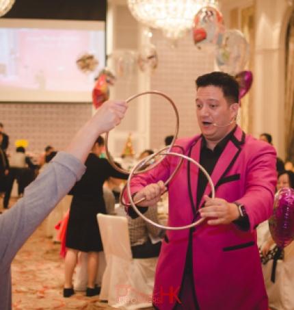 Hong Kong magician performing table magic three linking rings to a gentlemen at a children birthday party at Hong Kong Aberdeen marina club