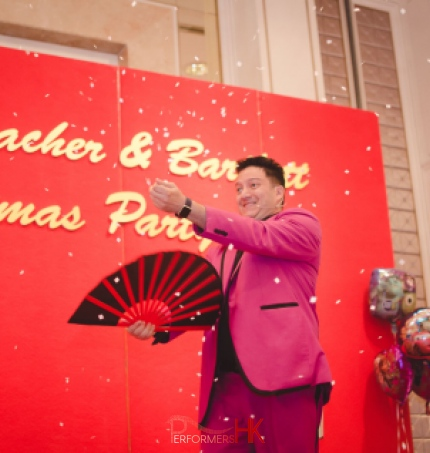 Magician performing snow storm magic trick with a fan at a corporate Christmas party at Aberdeen Marnia Club Hong Kong