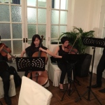 Four Hong Kong String players performing at the wedding reception