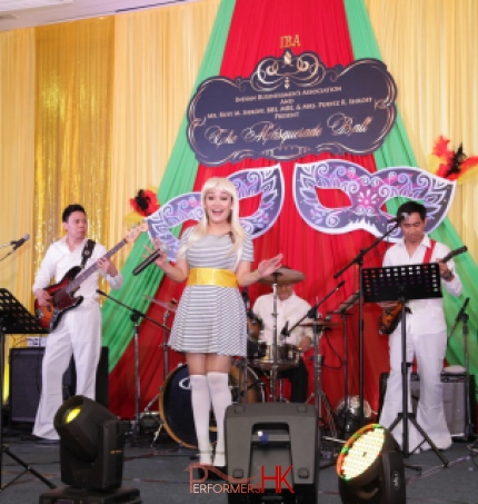 Band dressed in Abba clothing performing in hotel ballroom