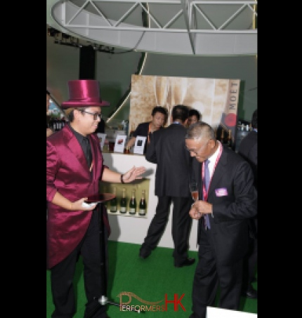 Magician performing a table magic trick at a corporate cocktail event in Hong Kong