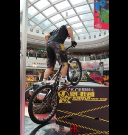 Hong Kong trial bike professional performer performing at a shopping mall summer function