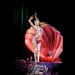 Contortion performer makes graceful movements in a shell.