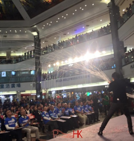Magician performing stage magic in Hong Kong at a shopping mall corporate event