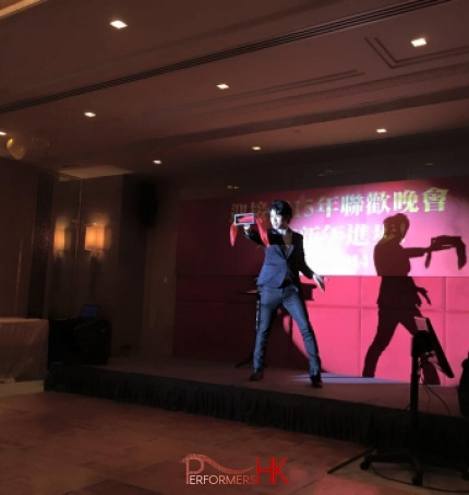 Magician performing stage magic with a box and silk at a Hong Kong corporate annual dinner
