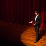 Bonn on stage explaining his tricks.