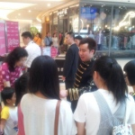 Working the crowds at the Popcorn mall in Hong Kong.