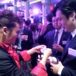 Calvin performing card magic at DBS cocktail party.